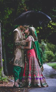 This is such a beautiful picture! Love the way her green dupatta and his green shalwar tie right in with the nature background.