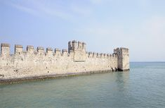 Castle at and in the water - outer wall of the Castello Scaligero Castle, Sirmione, Lago di Garda or Lake Garda, Lombardy, Italy, Europe. Click here to buy a poster, art print or canvas print: http://matthias-hauser.artistwebsites.com/featured/outer-wall-scaligero-castle-and-lake-garda-matthias-hauser.html 30 days money back guarantee. (c) Matthias Hauser hauserfoto.com