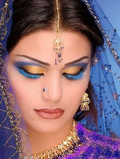 Love the twist on it with the blue lashes. Still very pretty it doesn't make it look avant garde at all