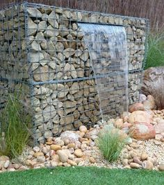 gabion wall design ideas garden water feature waterfall garden decorating ideas Have you ever wondered how you can incorporate a gabion into your interior We have a colle. Modern Landscaping, Backyard Landscaping, Backyard Fences, Gabion Wall Design, Gabion Retaining Wall, Gabion Stone, Landscape Design, Garden Design, Gabion Baskets