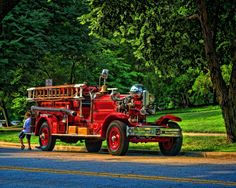 A Boy And His Fire Truck Photograph  - A Boy And His Fire Truck Fine Art Print