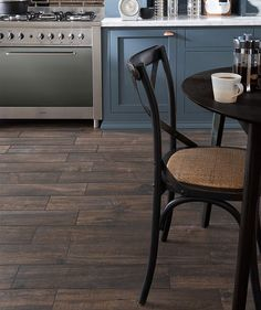 As the hub of any home, the kitchen floor has to put up with a lot. At Topps Tiles our range of Kitchen Floor Tiles offers stylish flooring you can rely on. Bathroom Flooring, Kitchen Flooring, Kitchen Tiles, New Kitchen, Topps Tiles, Wishbone Chair, Contemporary Interior, Home Kitchens, Home Remodeling