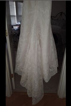 Perfect condition, never worn dress! Size 6 (Waist taken In but never hemmed). Timeless Lace Mermaid Style Dress. Includes removable delicate Lace Capped Sleeves.
