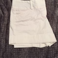 White shorts from express White shorts from express size 6 has a tiny spot on the front it's really hard to see. Express Shorts