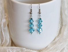 DeborahleedesignsCo find me on ETSY. Come on in and take a look around. Ski Blue Three Glass Crystal Earrings