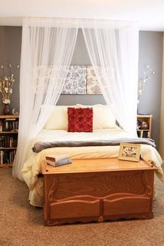 Ideas to make Bed canopy on budget. Use curtain rods, towel bars, or eye hooks on the ceiling and run fabric through