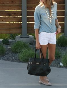 Denim shirt, white shorts, statement necklace.
