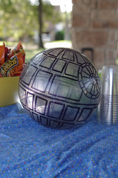 Star Wars birthday party: Death Star soccer ball made from a cheap Wal-mart ball and a sharpie.  Makes for a fun party soccer game :)