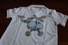 Camiisetasole. Camiseta patchwork con un helicóptero de aplicación hecho con telas combinadas.