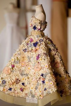 "~ The Dior in Miniature installation is a ""tribute to the meticulous handwork of the House of Dior Haute Couture ateliers whose talent is expressed in the miniature clothes that resemble the originals in every tiny detail""."