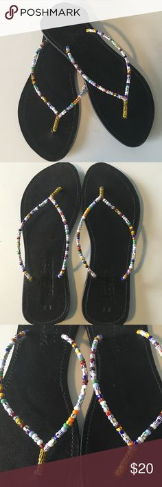 Beaded Flip Flops These beaded flip flops are perfect for a summer or not quite yet winter kind of day! It has been worn a few times but still in good condition. There are little marks toward the front of the shoe but they are not really noticeable. Let me know if you're interested! Kiki's Collection  Shoes