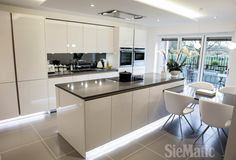 Clever lighting makes an island float in this SieMatic Pure kitchen by ArtHouse Creative Interiors