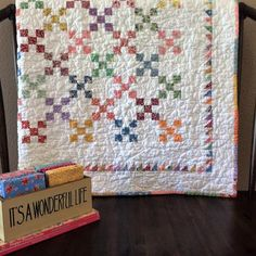 I have such good memories of making these quilts! This was a super fun quilt along we did in 2009 on Charming Chatter! I remember we had a giveaway contest where my sweet followers shared their ideas on naming this quilt! Esther came up with Half-Pint (the nickname Charles Ingalls...