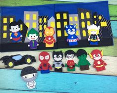 Heres a fun way to take those superheros on the go with you! Each book includes 4 heroes of your choice plus their super awesome hero-mobile to get them where they need to go! Includes a Bat Car too! Those heroes will be busy protecting the city from the bad guys and when playtime is over, just place the puppets in the city pocket and close up the book till next time.  They easily fit in backpacks and bags for on the go fun with your little one :)  Please allow up to 1 week for your puppet…