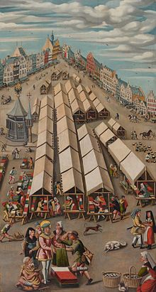 Jheronimus Bosch - Cloth Market in 's-Hertogenbosch.  Bosh lives in this square from 1462. The light blue house at your right was Bosch house.