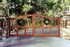 frame with open steel bar grids and more linear stonework on entrance columns. Also added copper sconces. Driveway Gate, Fence, Custom Gates, Steel Bar, Entrance Gates, Garden Bridge, Landscape Design, Sconces, Castle