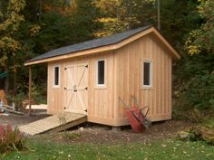 A 8 x 12 Garden Storage shed with an 8 overhang for firewood storage. Clad with Eastern white pine board and batten. The Shed has a continuous ridge beam site built) that cantlevers. Garden Tool Shed, Garden Storage Shed, Outdoor Storage Sheds, Outdoor Sheds, Garden Sheds, Outdoor Spaces, Outdoor Living, Diy Shed Plans, Storage Shed Plans