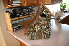 Birdhouse...   P.S- use really strong glue or the rocks will fall off.