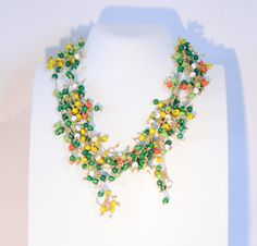 In flowery field colors statement necklace beaded by Cardoucci
