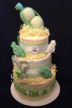 Two Peas in a Pod - This cake includes: 60 size 1 diapers, 3 large cotton flannel blankets, 6 washcloths, 2 pairs of no-scratch mittens, 2 BPA-free water filled teethers