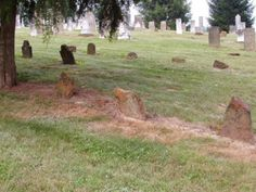 unmarked sandstone headstones of Indians who lived in the area and who were converted by the first settlers, in the very early 1800's.  Saint Paul-Myers Cemetery, Lancaster, Ohio