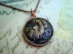 Antique 1926 BEE on FLOWER coin necklace, Italy 10 centissimo, art nouveau copper, with copper bail and antiqued copper bead chain. $18.95, via Etsy.