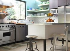 movable kitchen island with seating chair stool stove big window fruits shelves plates fridge cabinet contemporary style room of Wonderful Kitchens That Combine Movable Kitchen Island with Seating