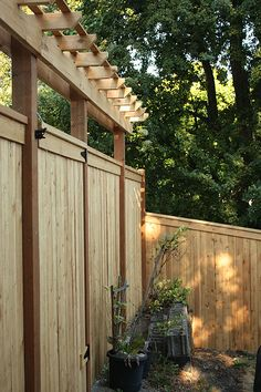 arbor top added for a little more visual height and to grow vines across them and hang twinkling lights or lanterns