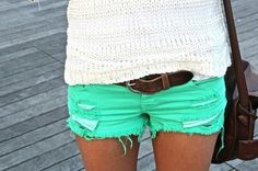 White shirt ` Bright green shorts ` Brown belt