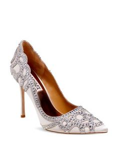 Ornately cut overlays shimmer with jewels at every turn on these lavish, show-stopping pumps by Badgley Mischka. | Satin upper, leather lining, leather sole | Imported | Fits true to size, order your