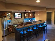 DIY basement bar fitted with concrete countertops. DIY cellar bar with concrete slabs. Rustic Basement Bar, Basement Bar Designs, Home Bar Designs, Basement Kitchen, Basement Ideas, Basement Bathroom, Modern Basement, Cozy Basement, Man Cave Basement
