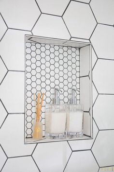 Shower tile ideas White Modern Bathroom Makeover 2019 Shower niche with white hexagon tile Hexagon Tile Bathroom, White Bathroom Tiles, Hexagon Tiles, Small Bathroom, Master Bathroom, Bathroom Showers, Dyi Bathroom, Bathroom Cabinets, Bathroom Shower Designs