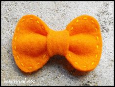 Felt hair bow - I adore the stitching and shape!