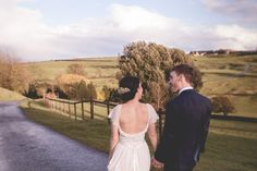 Cotswolds Barn Wedding By Claire Basiuk Photography and the Emme-waisted dress from Grace Loves Lace