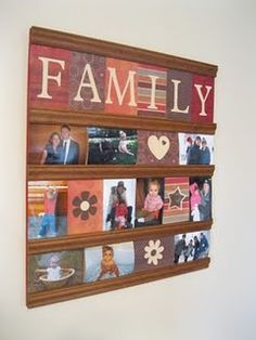 photo display for a family room - this could work in our home as my hubby doesn't allow me to punch holes in the walls to hang photographs...