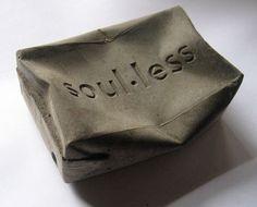 'soul.less' concrete squashed drink carton