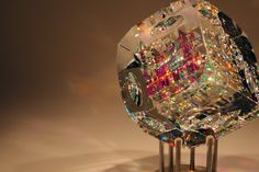 Beveled Cube is a contemporary glass sculpture by fine art glass artist Jack Storms. The core of the sculpture consists of the finest optical lead crystal.