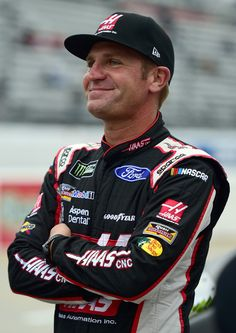 Clint Bowyer, driver of the #14 Haas Automation Ford, stands on the grid prior to qualifying for the Monster Energy NASCAR Cup Series First Data 500 at Martinsville Speedway on October 29, 2017 in Martinsville, Virginia.