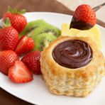 Chocolate Fondue Cups from Campbell's Kitchen . Sharing isn't necessary when you fill individual puff pastry shells with this exquisite chocolate fondue. Serve with fresh fruit and everyone can enjoy their own dessert. Profiteroles, Croquembouche, Just Desserts, Delicious Desserts, Dessert Recipes, Mini Desserts, Health Desserts, Yummy Food, Iftar