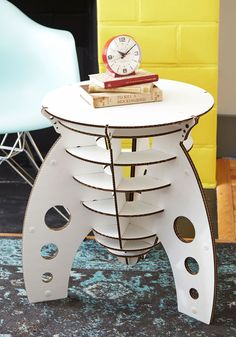 Have a Blast Off Table. Whether it sits next to your couch, holding a cluster of photographs, or next to your bed for your books and alarm clock, this rocket-shaped cardboard side table is the perfect planetary accompaniment! #white #modcloth