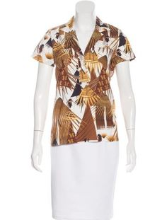 Brown and white Marni short sleeve top with notched collar, abstract print throughout, dual patch pockets and contrast stitching.