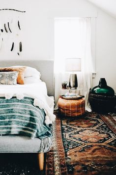 Bohemian bedroom leather Moroccan pouf woven indigo blanket white bedding kilim … - Bohemian Home Bedroom Bohemian Bedroom Decor, Home Decor Bedroom, Moroccan Bedroom Decor, Modern Bedroom, Master Bedroom, Artistic Bedroom, Tribal Bedroom, Bohemian Bedding, Stylish Bedroom