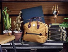 South2 West8, a Japanese line of classic outdoor sportswear and accessories. their bags are, interestingly enough, produced in the USA