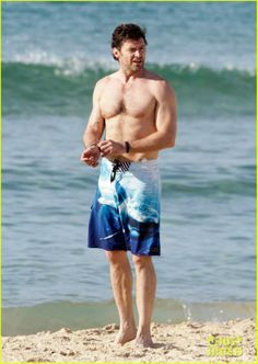 Hugh walking on Beach after workout with trainer in Australia