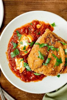 NYT Cooking: In most eggplant Parmesan recipes, crusty slices of fried eggplant go into a casserole with sauce and cheese -- where they quickly turn to sludge. This recipe holds on to the crunch by transforming each whole eggplant into a crisp cutlet. Pasta Recipes, Dinner Recipes, Parmesan Recipes, Cooking Recipes, Healthy Recipes, Crispy Eggplant, Eggplant Parmesan, Vegetarian Main Dishes, Vegetarian Entrees