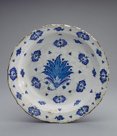 Dish  Turkey, Iznik. Second qurter of 16th century	 Faience; underglaze painting. Diam. 38 cm  Source of Entry:   First Branch of the State Hermitage Museum(former Museum of the Stieglitz School). 1925 The State Hermitage Museum