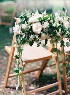 Absolutely romantic! Ceremony chairs draped with lush floral garlands. Catherine Mead   Snippet & Ink