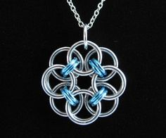 FREE Tutorial on how to make this beautiful Chainmaille Rose pendant out of a few ID rings. Would make for a great last minute homemade gift for those DIY-ers who craft their presents