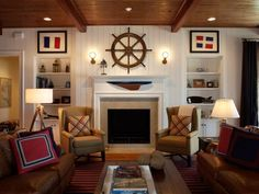 Nautical living room with ship wheel above fireplace, and framed signal flags.