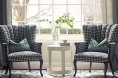 i love the houndstooth fabric on the chairs with the pops of blue